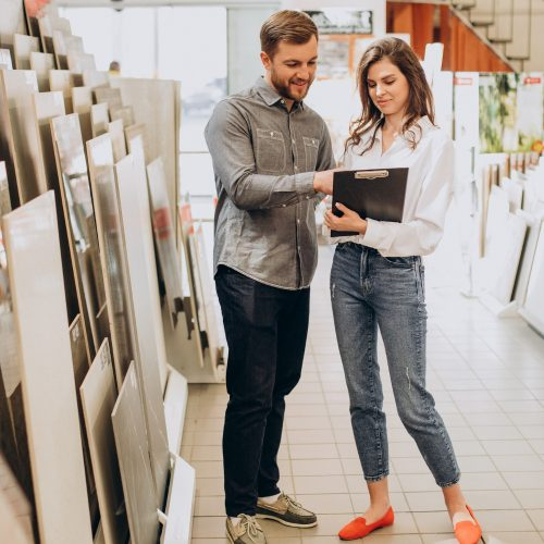 young-couple-choosing-tiles-at-building-market